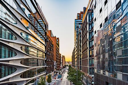 Manhattan, New York, USA - August 29, 2019: High Line Park in Manhattan. View of the surrounding houses and parks. High Line is a popular linear park built on elevated railway tracks.