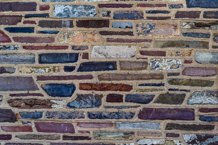 Multi Color Treated Brick Stone Surface Background, New Jersey, USA.
