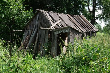 abandoned farmhouse abandoned farmhouse: Old ruined barn in the countryside Russian federation