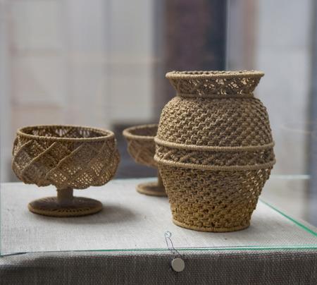 bonding rope: Vase made in the technique of macrame Stock Photo