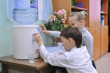 Children collect water from the cooler