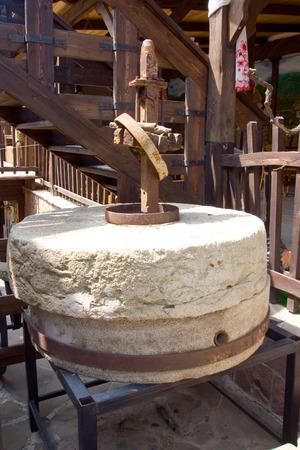 millstone: Stone millstone old mill Stock Photo