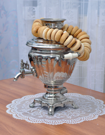 baranka: Standing on the table Russian samovar and a bunch of bagels Stock Photo