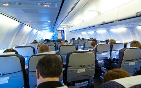 Airplane passenger in the cabin 스톡 콘텐츠