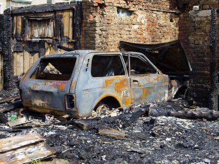 home destruction: Burned garage and car Stock Photo