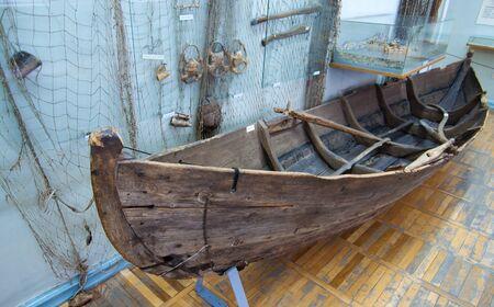 saami: Old wooden boat indigenous inhabitants of the Kola Peninsula Editorial