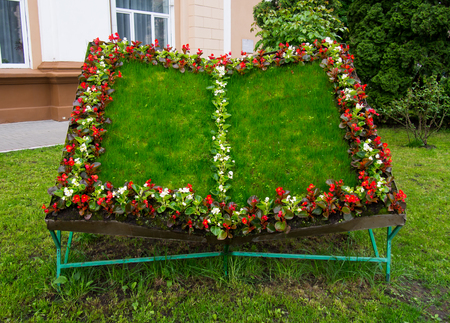 A flower bed in the form of an open book