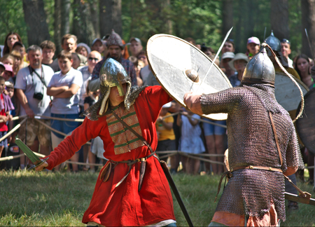 Smolensk, Russia - August 09, 2014, Fight the two soldiers in the old Russian armor at the festival of historical reconstruction Gnezdovo