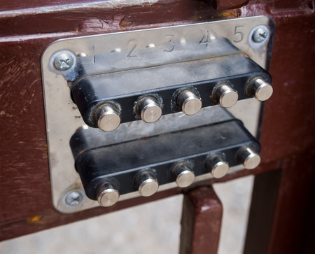 combination: Mechanical combination lock installed in the gate Stock Photo