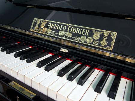 manufactured: Alushta, Russia - June 08, 2016: Antique piano manufactured Arnold Fibiger in Sergeyev-Tsensky house