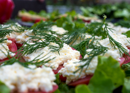 Appetizer of tomato with grated cheese and dill Stock Photo