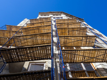 updated: Scaffolding installed in the facade of a building under construction
