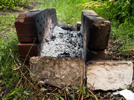 Homemade brazier of old bricks