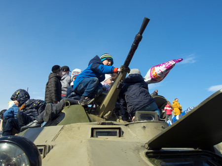 Gadjievo, Russia - May 09, 2015: Children play on the armor of military equipment during the Exhibition of Arms Editorial