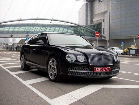 spur: Moscow, Russia - November 07, 2015: Executive car Bentley Flying Spur with diplomatic plates in front of the Sheremetyevo airport