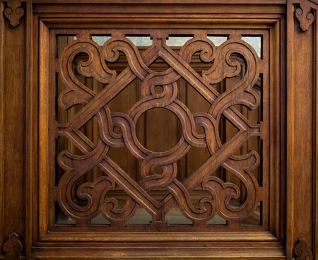 Old carved wooden lattice with a geometrical pattern