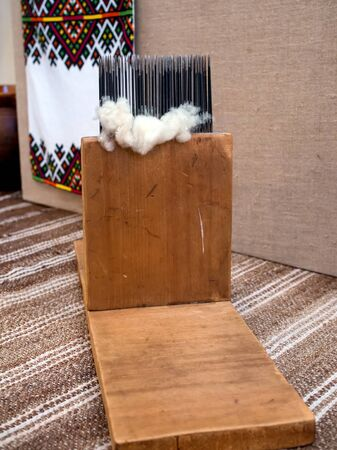 carding: Old wooden device for carding wool before spinning