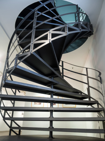 second floor: Metal spiral staircase to the second floor of the building Stock Photo