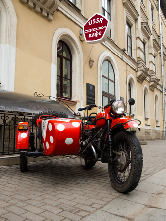 Saint-Petersburg, Russia - February 13, 2016: The old Soviet motorcycle at the entrance of USSR cafe on Malaya Sadovaya street Editorial
