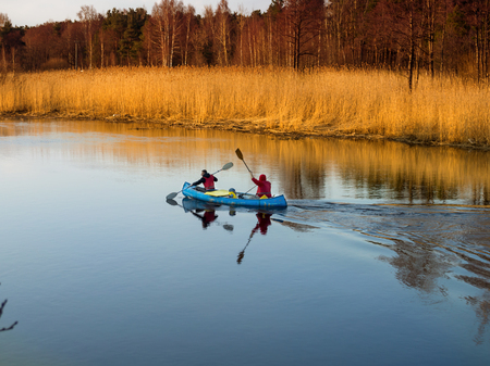 Sosnovy Bor, Russia - April 7, 2016: Tourists floating on the river Kovash Leningrad region by kayak