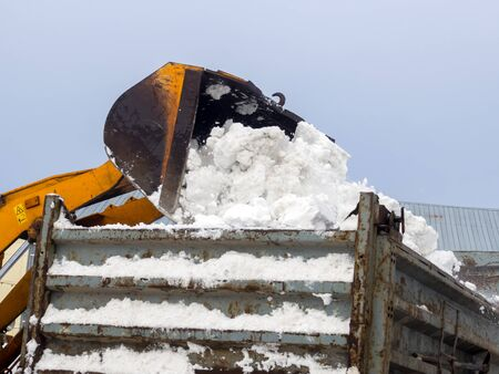 Loading snow into trucks for removal