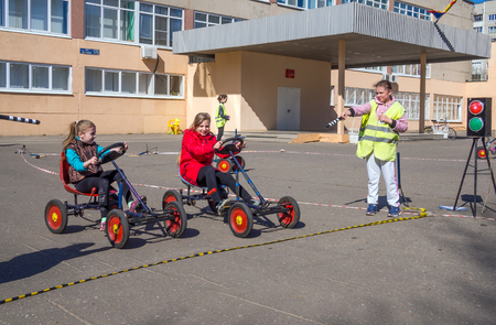Voronezh, Russia - April 26, 2017: Schoolchildren play on the site according to the rules of the road Editorial
