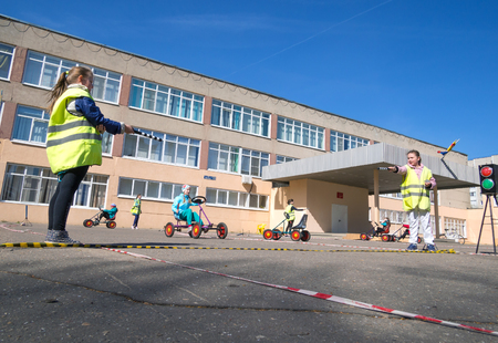 playground rides: Voronezh, Russia - April 26, 2017: Children learn rules of the road in the form of the game