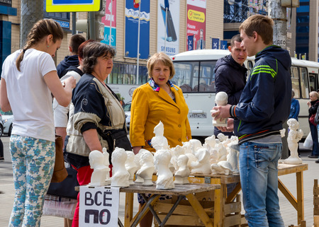 Voronezh, Russia - May 01, 2017: Sale of gypsum figurines in the streets of Voronezh