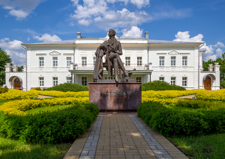 Novozhivotinnoe, Russia - May 26, 2017: The sculpture of the poet and the building of the museum-estate of D. Venevitinov Editorial
