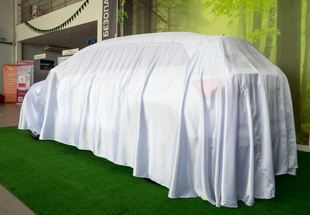 Voronezh, Russia - June 04, 2017: New car hidden under the cover before the premiere Stock Photo