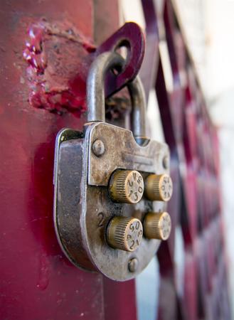 Vintage mechanical combination lock hanging on doors Stock Photo