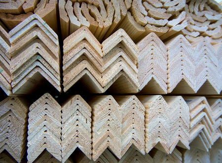 moulding: Stacking with wooden corner profile in stock Stock Photo