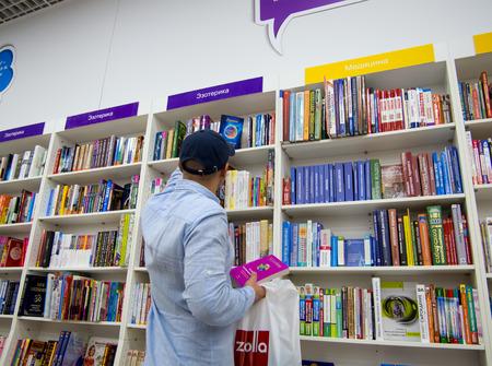 Voronezh, Russia - June 11, 2017: A man chooses books in a bookstore