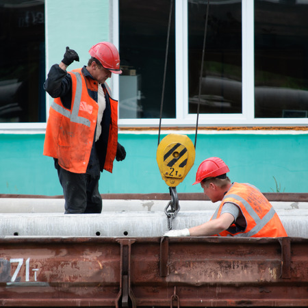 Vyazma, Russia - July 04, 2011: Workers on the railways are loading Editorial