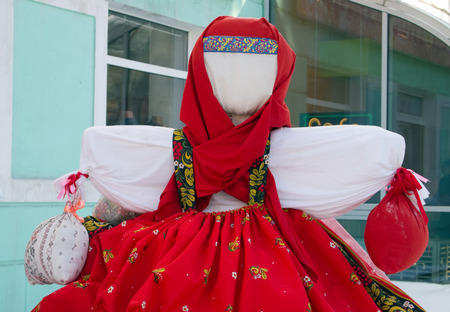 Rag doll on the street is decorated with holiday Maslenitsa