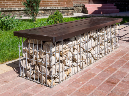 Bench made of cobblestones, fixed with steel mesh Stock Photo