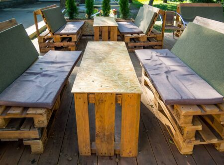 Voronezh, Russia - August 20, 2018: Furniture for outdoor cafes from old pallets
