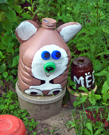 Bear with a barrel of honey, made from old used plastic bottles