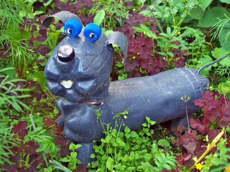 Dog made from old used plastic bottles