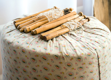 Antique cushion with bobbins for weaving lace