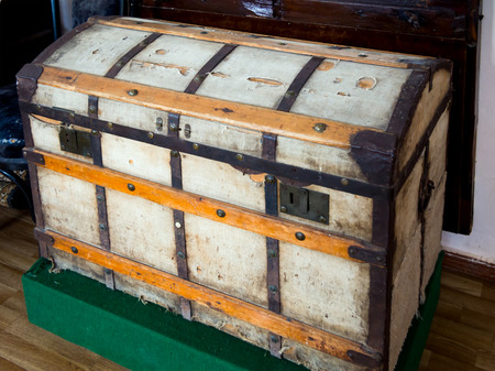 Vintage wooden chest covered with old cloth