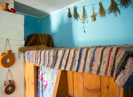 Zadonsk, Russia - August 28, 2018: The bed behind the stove in a village house, reconstruction of the Zadonsk Museum of Local Lore