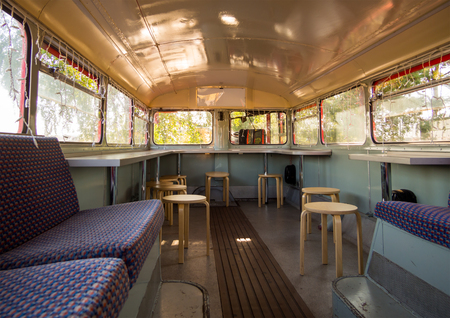 Alteration of the cabin of the old bus in a cafe with a bar