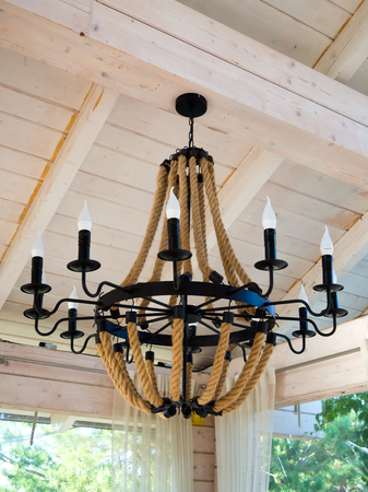 Wrought iron chandelier with ropes in an unusual style