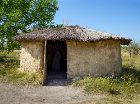 Mud hut with a reed roof, archaeological park