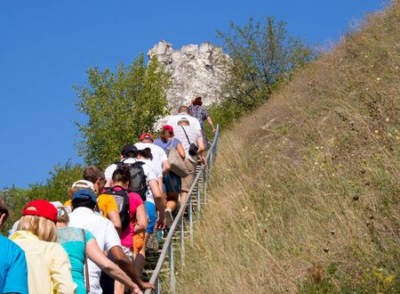 Divnogorye, Russia - September 9, 2018:Tourists climb to the cave temple of the Assumption Monastery in the nature reserve Divnogorye, Voronezh region Editorial