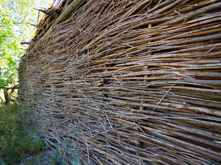Hut wall made of twisted rods and twigs Stock Photo