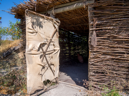 Entrance to the hut made of binding rods, archaeological park
