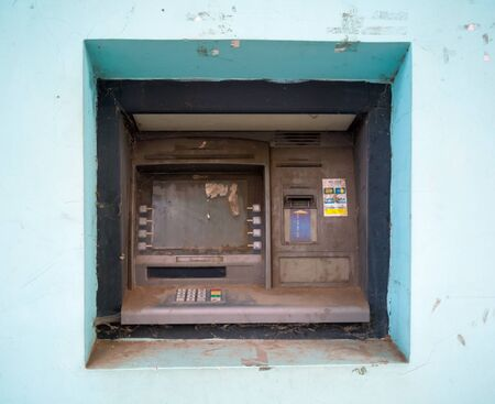 Alushta, Russia - September 13, 2018: Abandoned ATM in the wall of the building