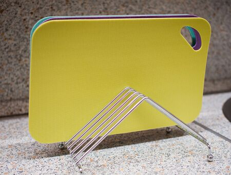 Set of multi-colored cutting boards on a metal stand Imagens